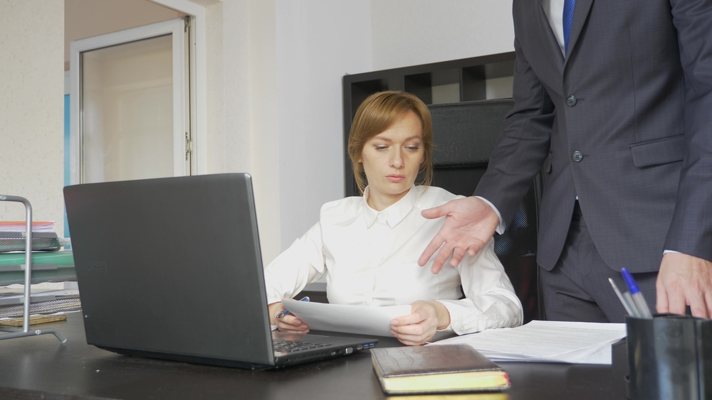 Angry boss with female worker in the office